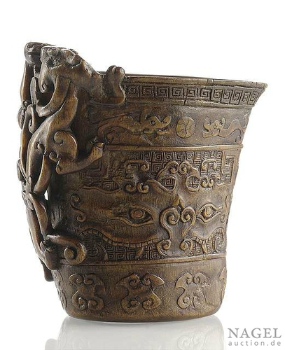 A well carved rhinoceros horn libation cup, China, 18th century