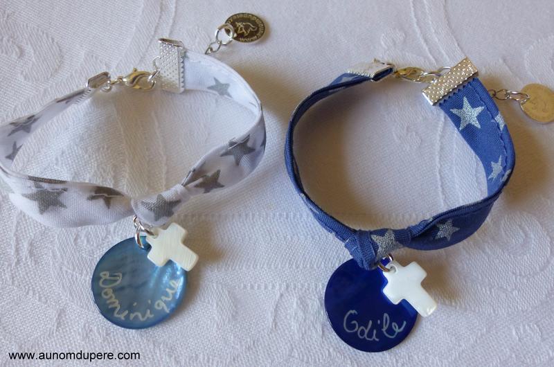 Bracelet sur ruban composé d'une médaille en nacre et une mini Croix en nacre - 18 €