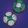 A pair of spectacular emerald, diamond, and colored diamond ear clips, by jar