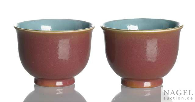 A fine and rare pair of ruby-red and turquoise-glazed porcelain wine cups, China, underglaze blue Qianlong mark and period