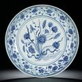 A rare large blue and white 'lotus bouquet' dish. ming dynasty, yongle period