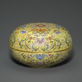 A yellow ground circular box and cover with famille rose enamel decoration, qianlong mark