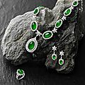 A jadeite and diamond necklace, earring and ring suite
