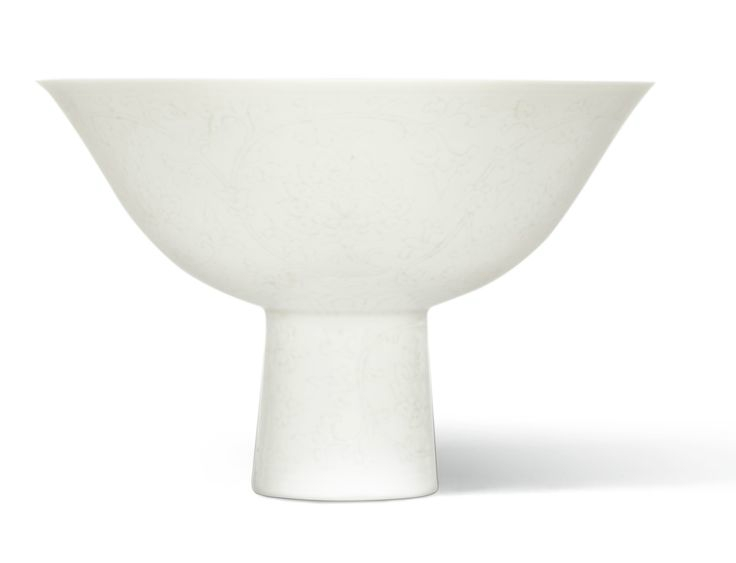 An incised white-glazed 'Lotus' stemcup, Qianlong mark and period