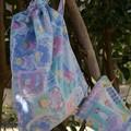 Doudou étiquette et pochette à bébé