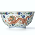 A fine wucai 'Dragon and Phoenix' bowl, Seal mark and period of Jiaqing