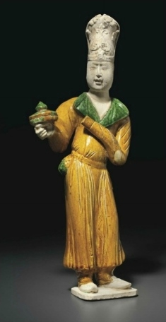 A rare glazed pottery figure of a foreign tribute bearer, Tang dynasty, 8th century