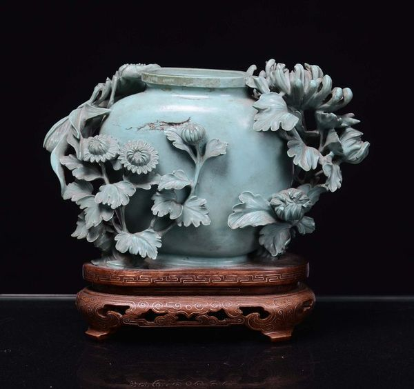 _small_turquoise_vase_decorated_with_flowers_1368186047942476