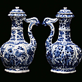 A pair of white and blue porcelain ewers, china, qing dynasy, kangxi period (1662-1722)