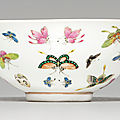 A famille rose 'butterfly' bowl, guangxu six-character mark in iron red and of the period (1875-1908)