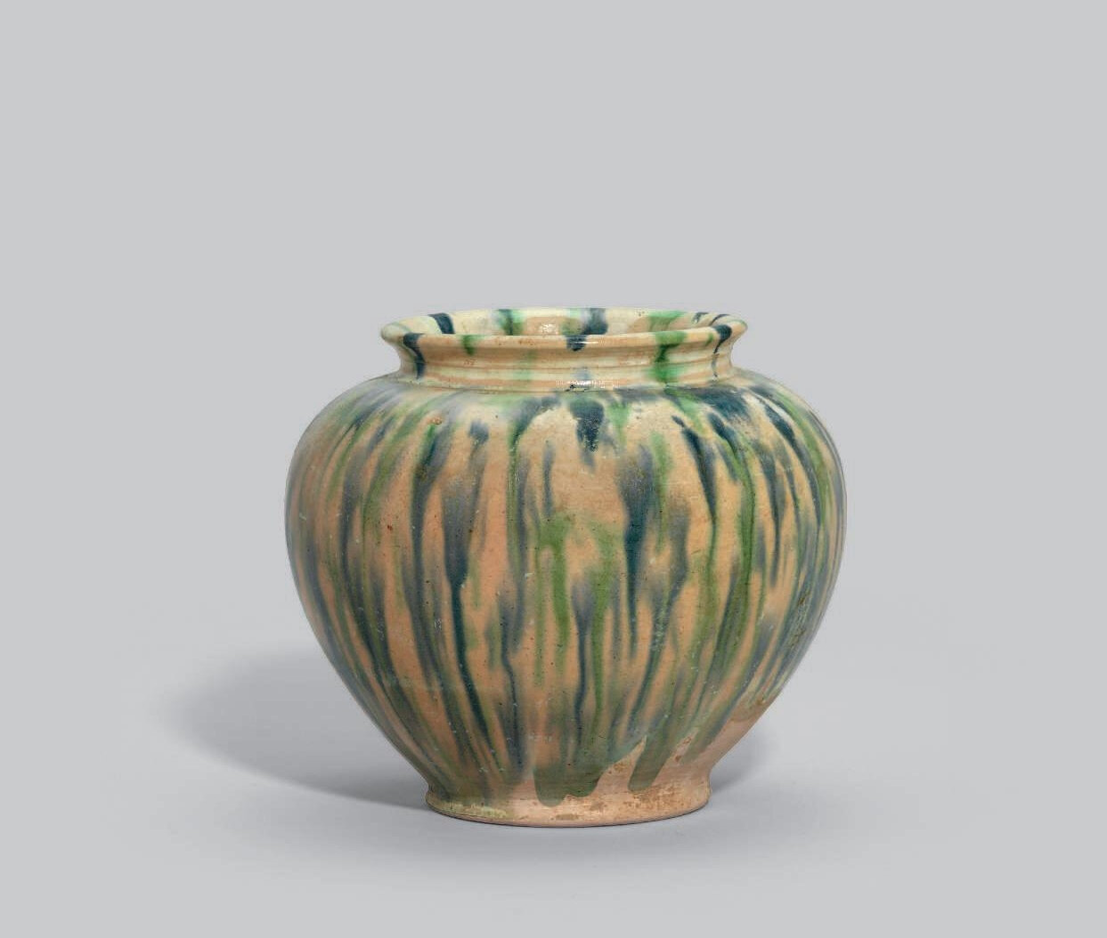 A sancai-glazed blue-splashed pottery jar, Tang dynasty (618-907)