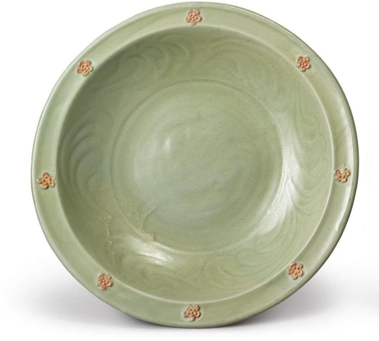 A 'Longquan' celadon-glazed and biscuit-decorated dish, Yuan dynasty (1279-1368)