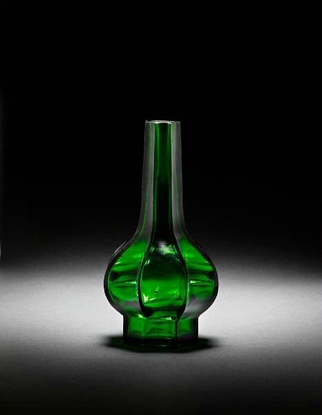 An octagonal facetted green glass bottle vase. Qianlong wheel-cut four-character mark and of the period. photo Bonhams