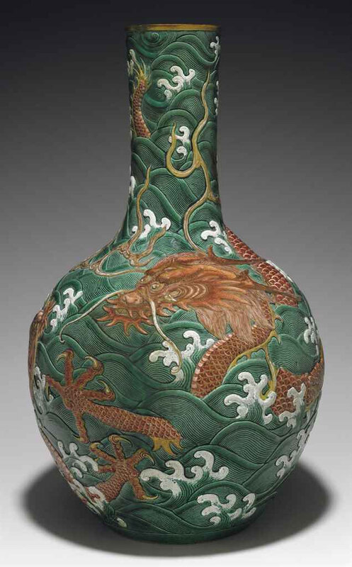2011_NYR_02427_1833_000(a_large_iron-red-decorated_green_and_white-enameled_carved_vase_tianqi)