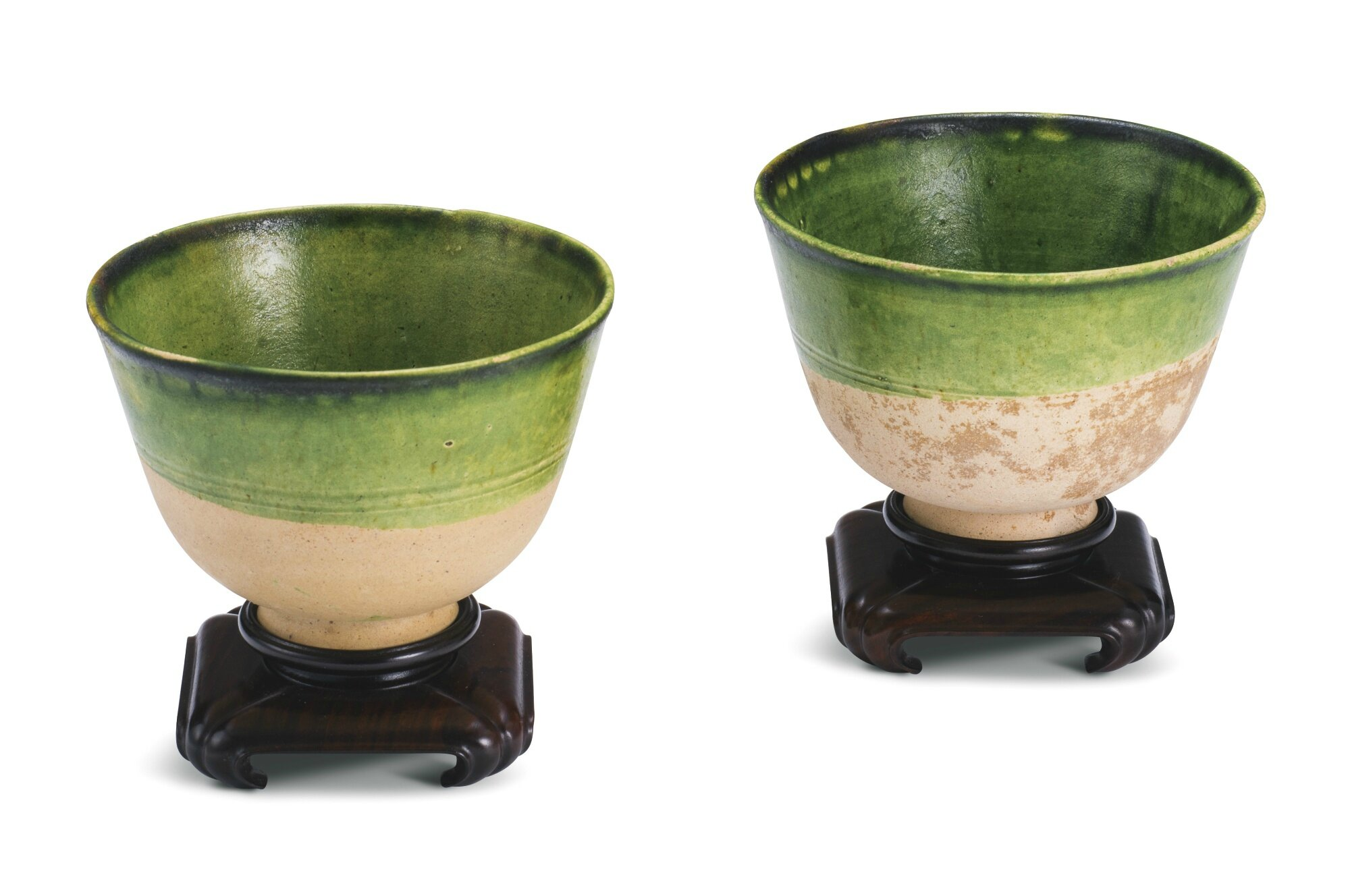 A pair of green-glazed pottery cups, Tang dynasty (618-907)