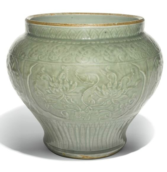 A 'Longquan' celadon carved jar, Ming Dynasty, 15th Century