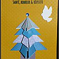 carte de voeux jaune avec sapin bleu en origami