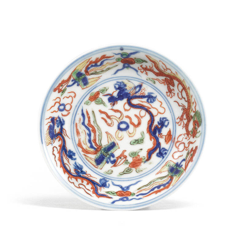 A rare small wucai 'Dragon and Phoenix' dish, Wanli six-character mark within a double circle in underglaze blue and of the period (1573-1619)