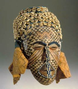 X JEU kuba- African, Kuba culture-Ngady amwaash Mask-1800s-1900s-Sculpture Wood paint glass beads cowrie shells string raffia cloth-Virginia Museum of Fine Arts