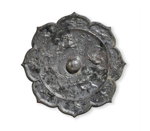 A silvery bronze petal-lobed mirror China, Tang dynasty (AD 618-907)