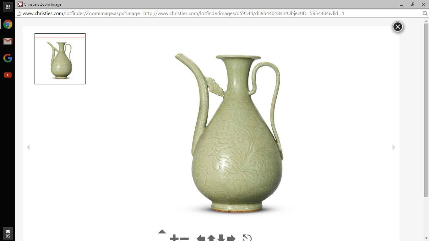 A carved Longquan celadon ewer, Early Ming dynasty, 15th century