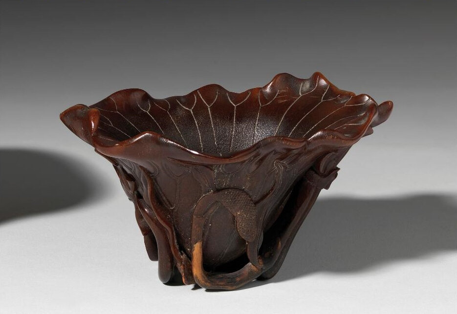 A carved rhinoceros horn libation cup, China, Qing dynasty, 17th century