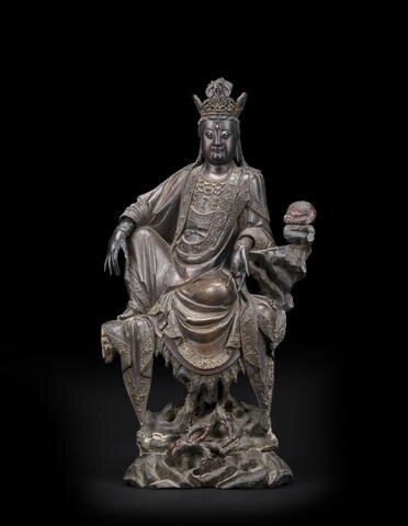 A large lacquered wood figure of Guanyin, 18th century