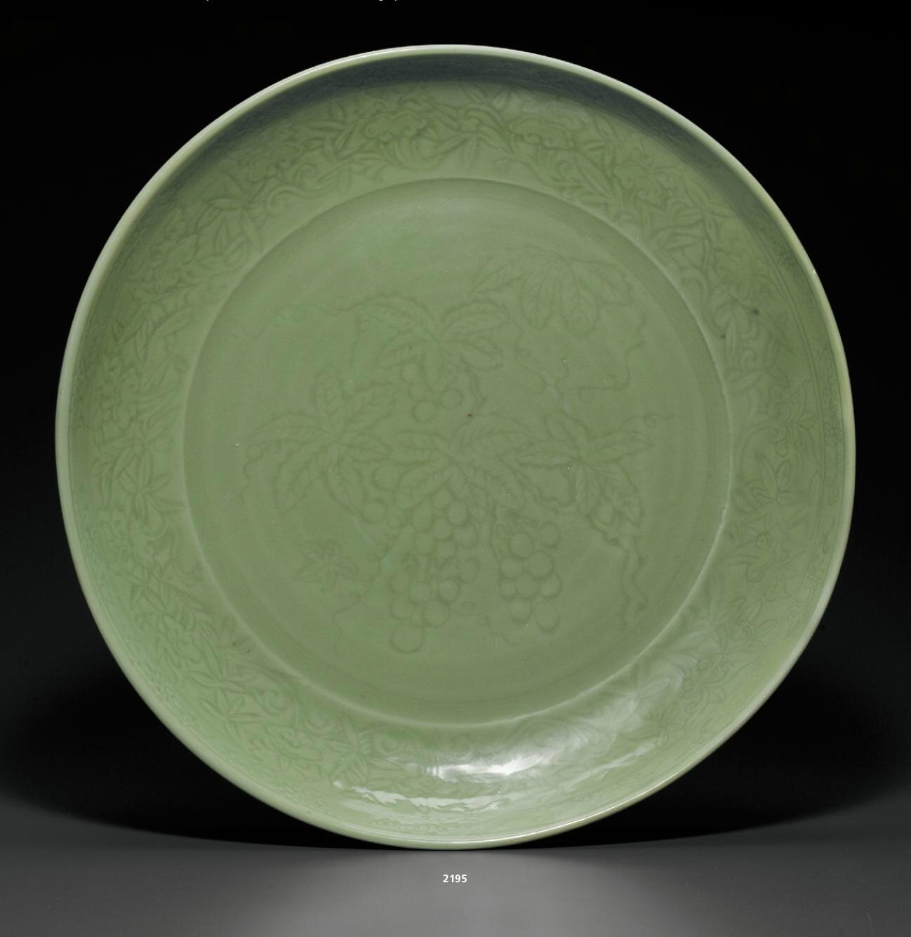 A rare very large Longquan celadon carved dish, Early Ming dynasty, early 15th century