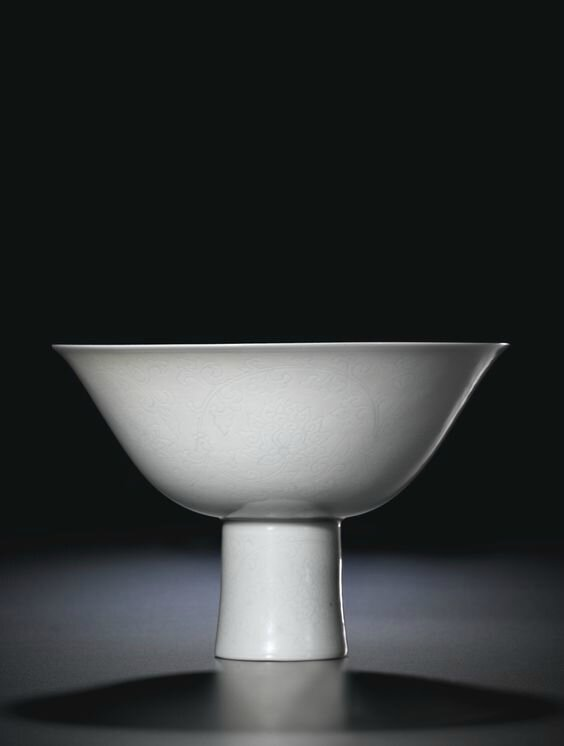 A fine incised white-glazed 'Lotus'  stembowl, Incised seal mark and period of Qianlong