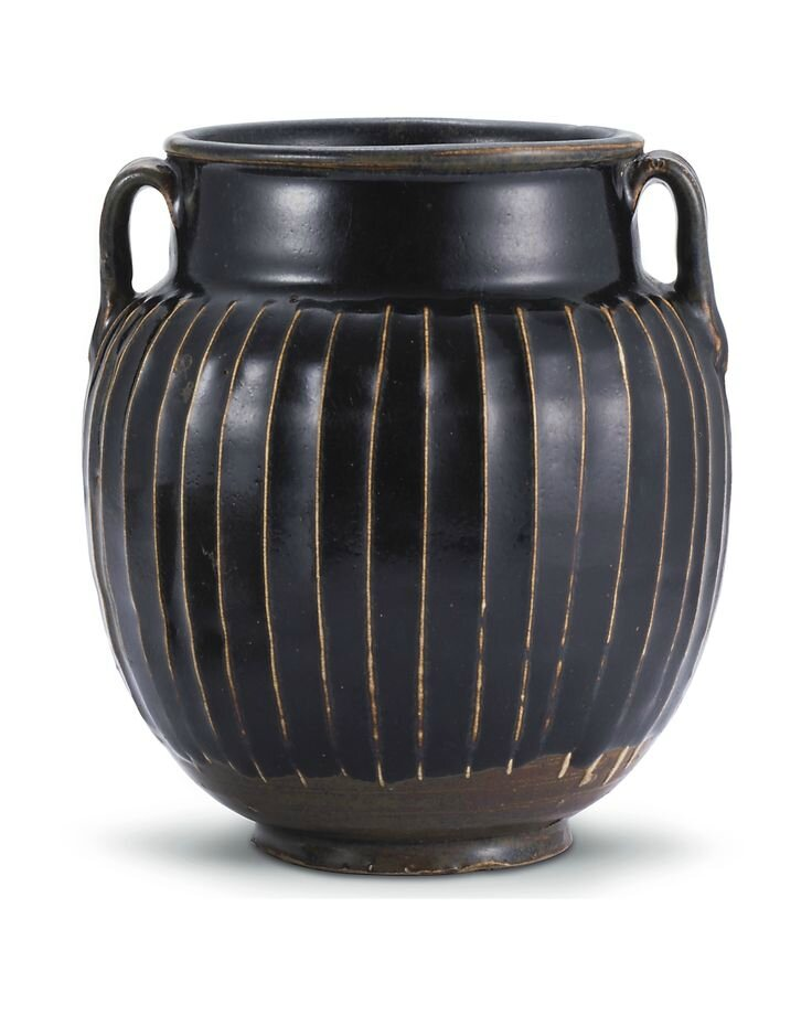A 'Henan' black-glazed ribbed jar, Song dynasty