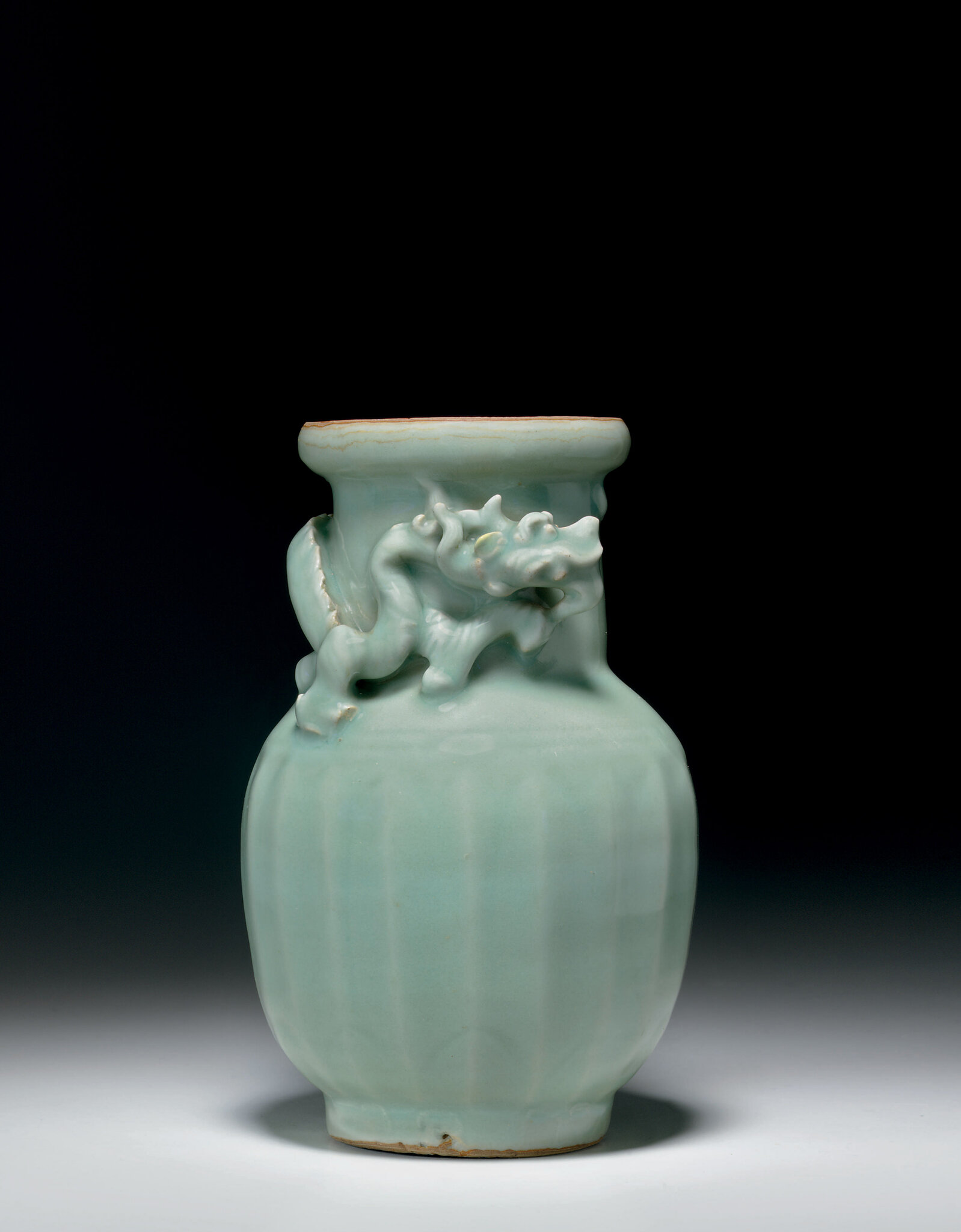 A rare carved Longquan celadon jar, Southern Song dynasty (1127-1279)