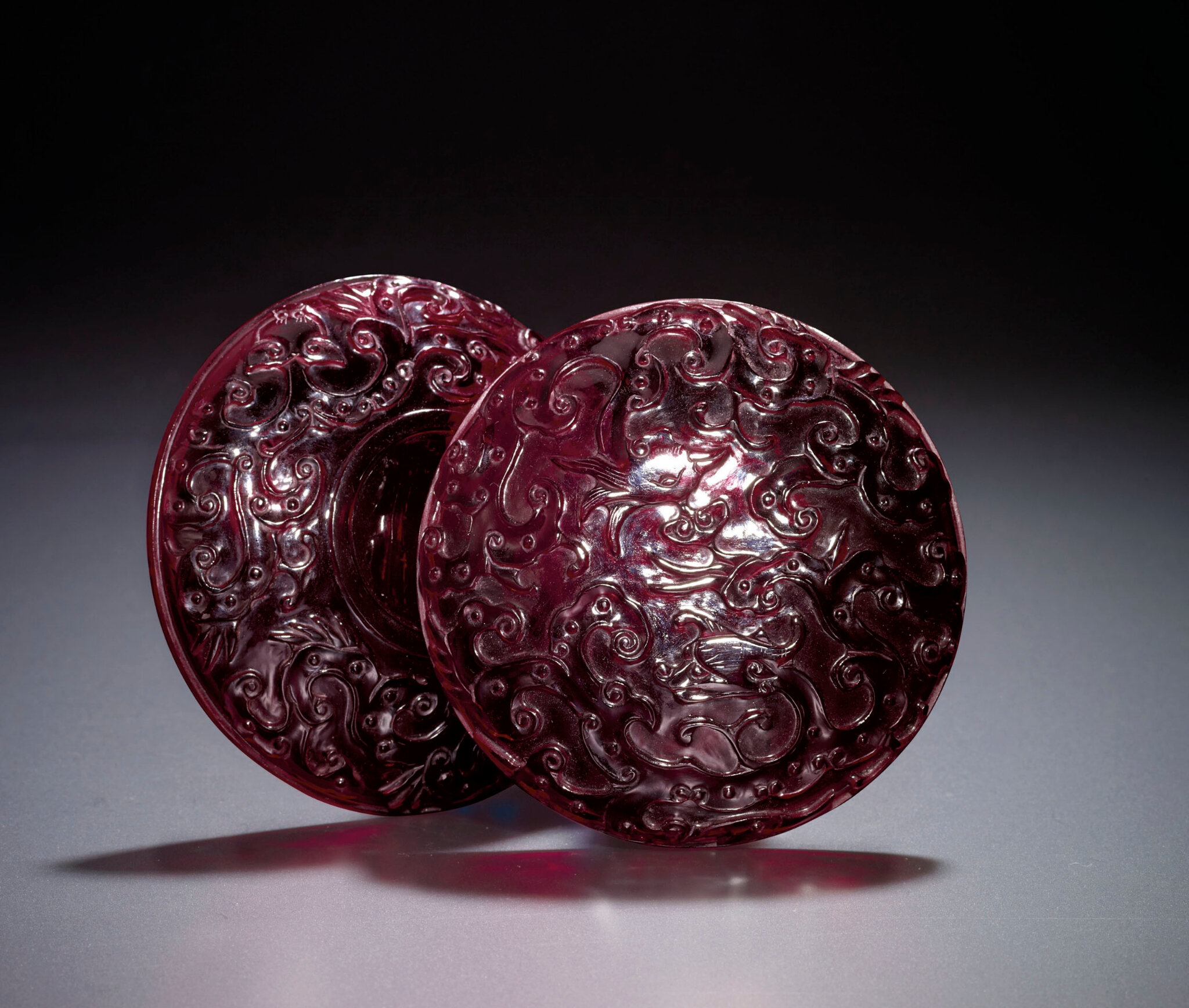 A rare carved ruby-red glass circular box and cover, Qianlong period (1736-1795)
