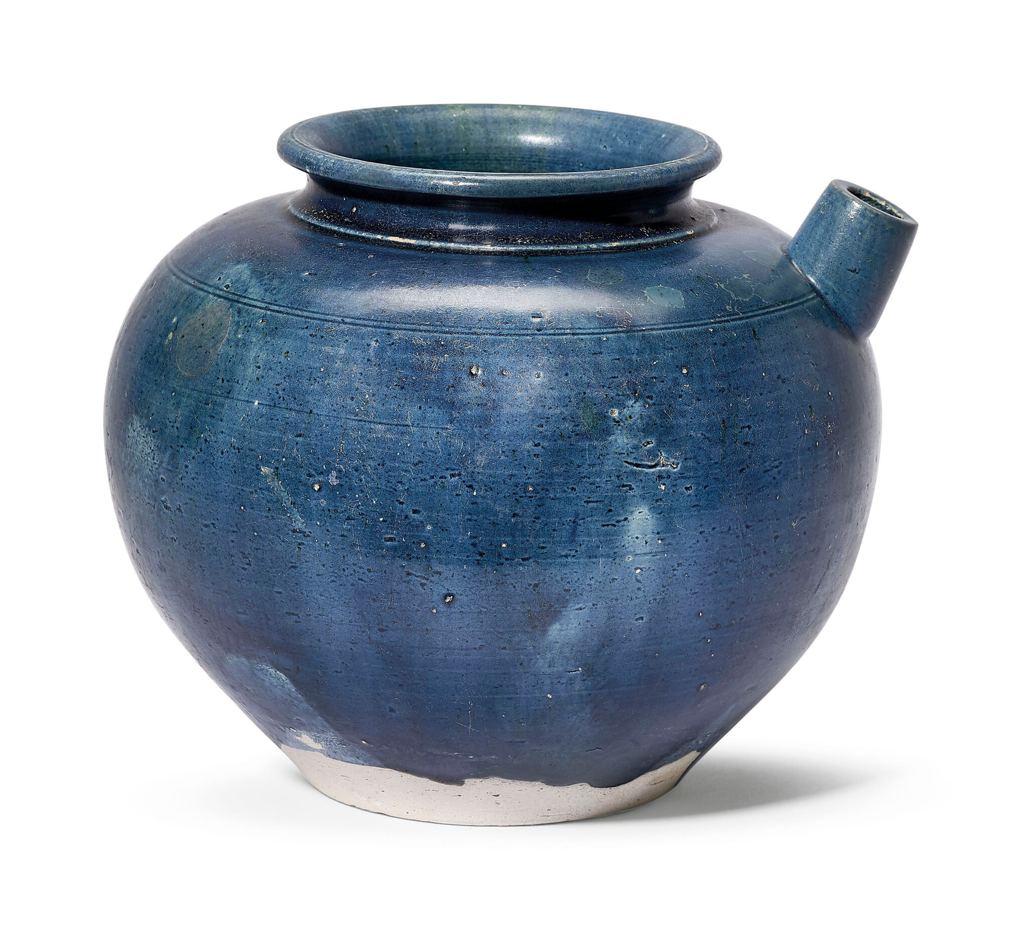 A blue and amber-glazed pouring vessel, Tang dynasty (618-907)