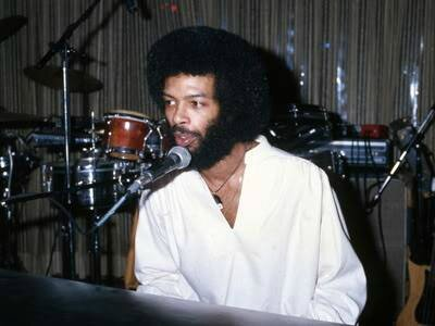 Musician and poet Gil Scott-Heron performs onstage in circa 1977