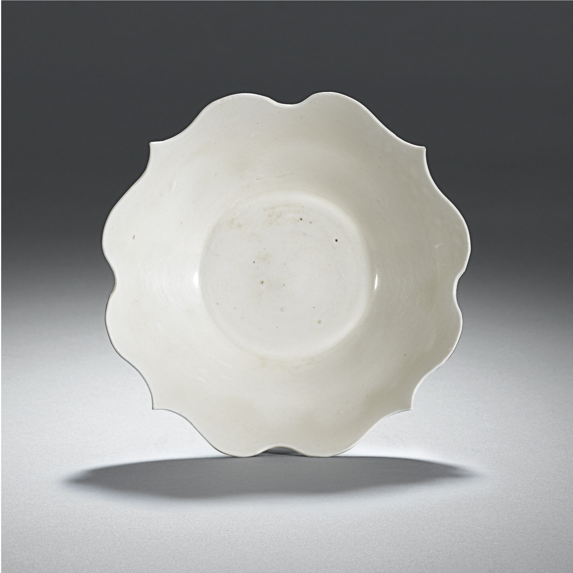 Lot 6. A quatrefoil white Dingyao dish,Five dynasties, 10th Century; 16.8cm., 6 5/8 in. Estimate 30,000—40,000 GBP. Lot Sold 37,250 GBP. Photo Sotheby's 2011