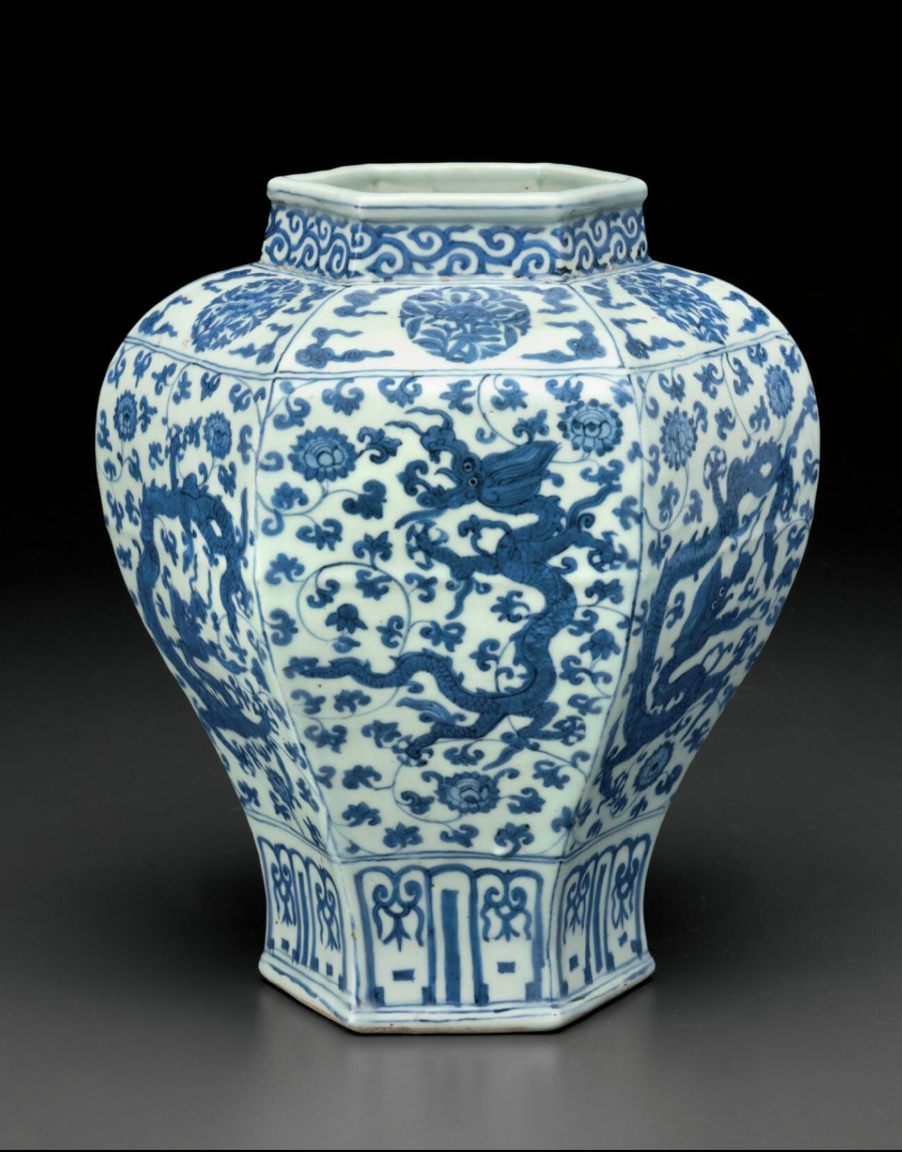 A very rare blue and white hexagonal 'Dragon' jar, Jiajing six-character mark in underglaze blue within double-circles and of the period (1522-1566)