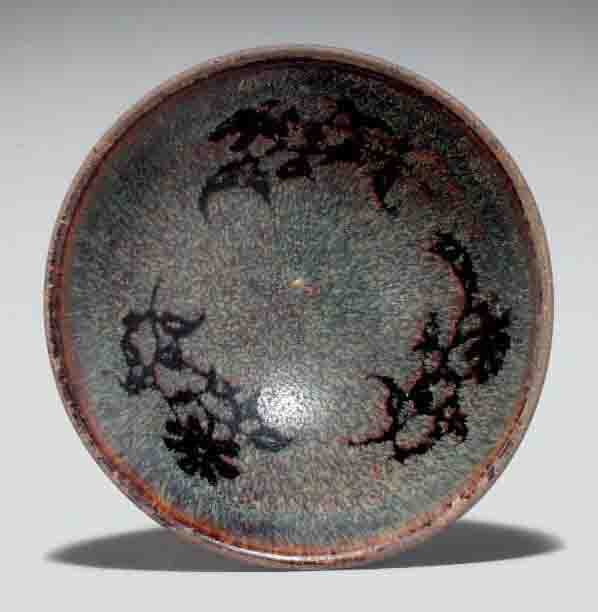 A paper-cut resist-decorated Jizhou bowl, Southern Song dynasty, 12th-13th century