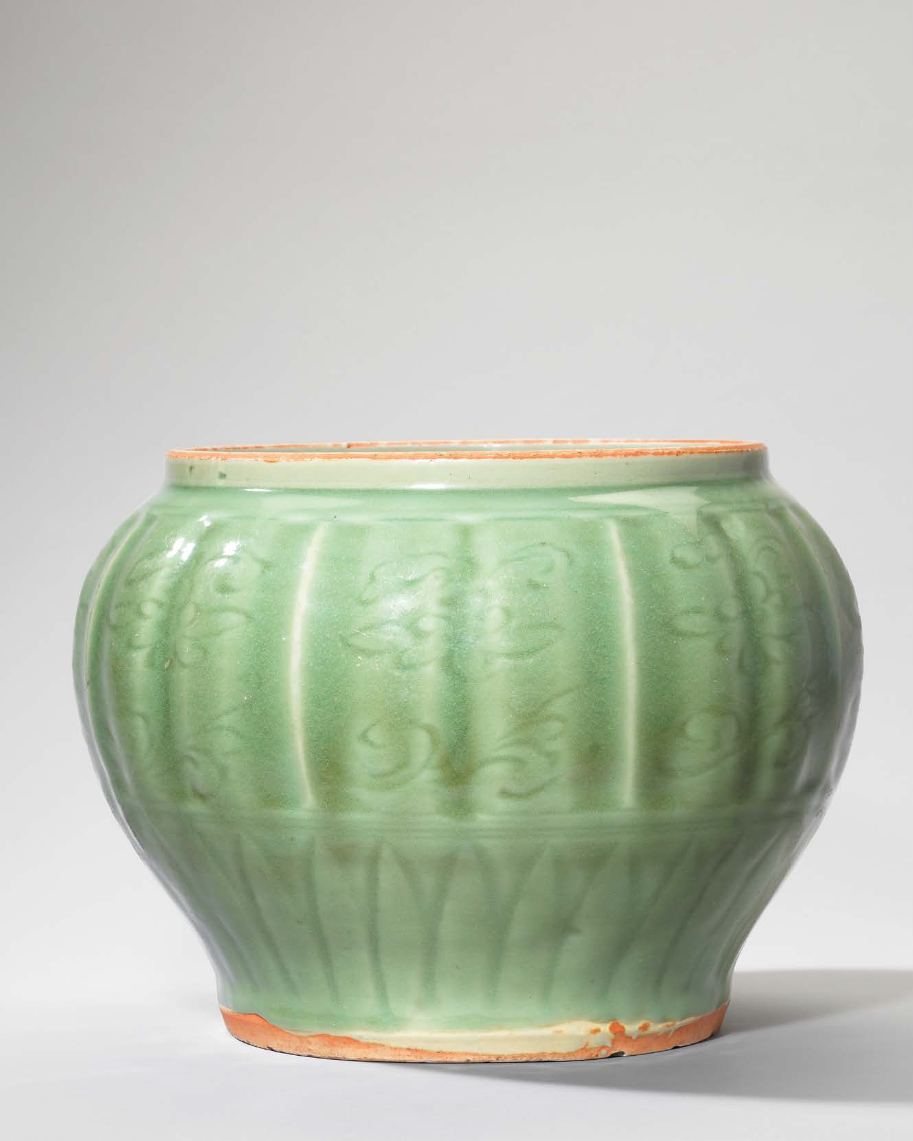 A rare Longquan celadon carved and moulded 'Sea creatures' jar, Yuan dynasty (1279-1368)