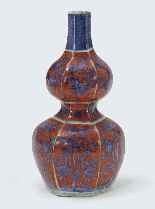 An unusual iron-red and blue and white hexagonal double-gourd vase, Wanli period (1573-1619)