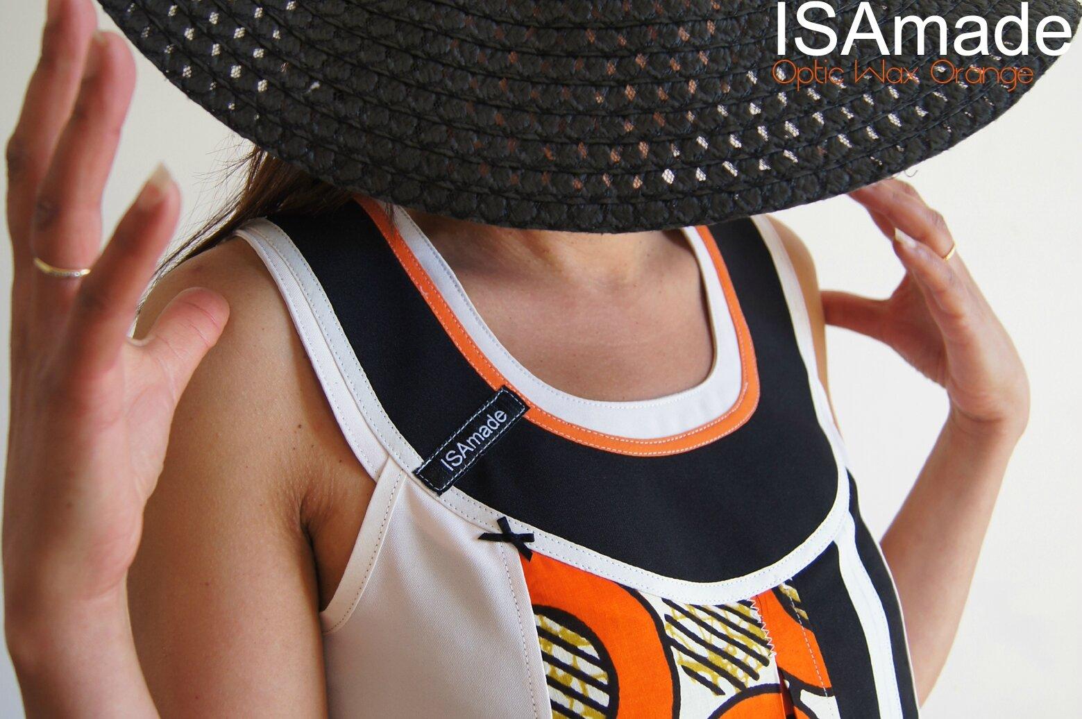 Robe trapèze Graphique ethnique Blanc écru imprimé wax africain avant gardiste design optique orange/ noir