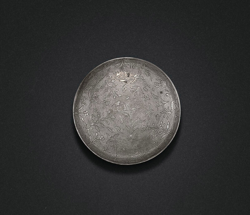 A small silver circular 'bird and flower' box and cover, Tang dynasty (618-907)