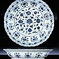 A magnificent early Ming blue and white barbed-rim dish, Yongle period (1403-1425)