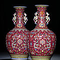 An exceptionally fine and rare pair of ruby-red ground famille rose vases, qianlong six-character seal marks and of the period