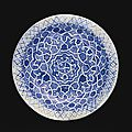 A timurid blue and white pottery dish with geometric design, persia, 15th century
