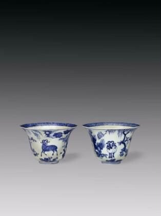 Pair of blue-and-white bell-shaped wine cups with three rams and the sun, Jiajing period (1522-1566), Ming dynasty. Porcelain, Jingdezhen, Jiangxi province. Width 16.4 cm. Height 10.5 cm. Purchased in 1957. Collection of the University Museum and Art Galle