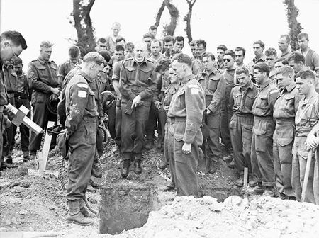 H_Captain_Callum_Thompson,_a_Canadian_chaplain,_conducting_a_funeral_service_in_the_Normandy_bridgehead,_France,_16_July_1944