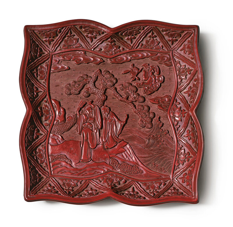 A rare and finely carved lacquer 'Immortals' quatrefoil tray, Ming dynasty, 16th century