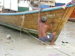 man_painting_boat