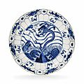 A molded blue and white dish, Kangxi period (1662-1722)