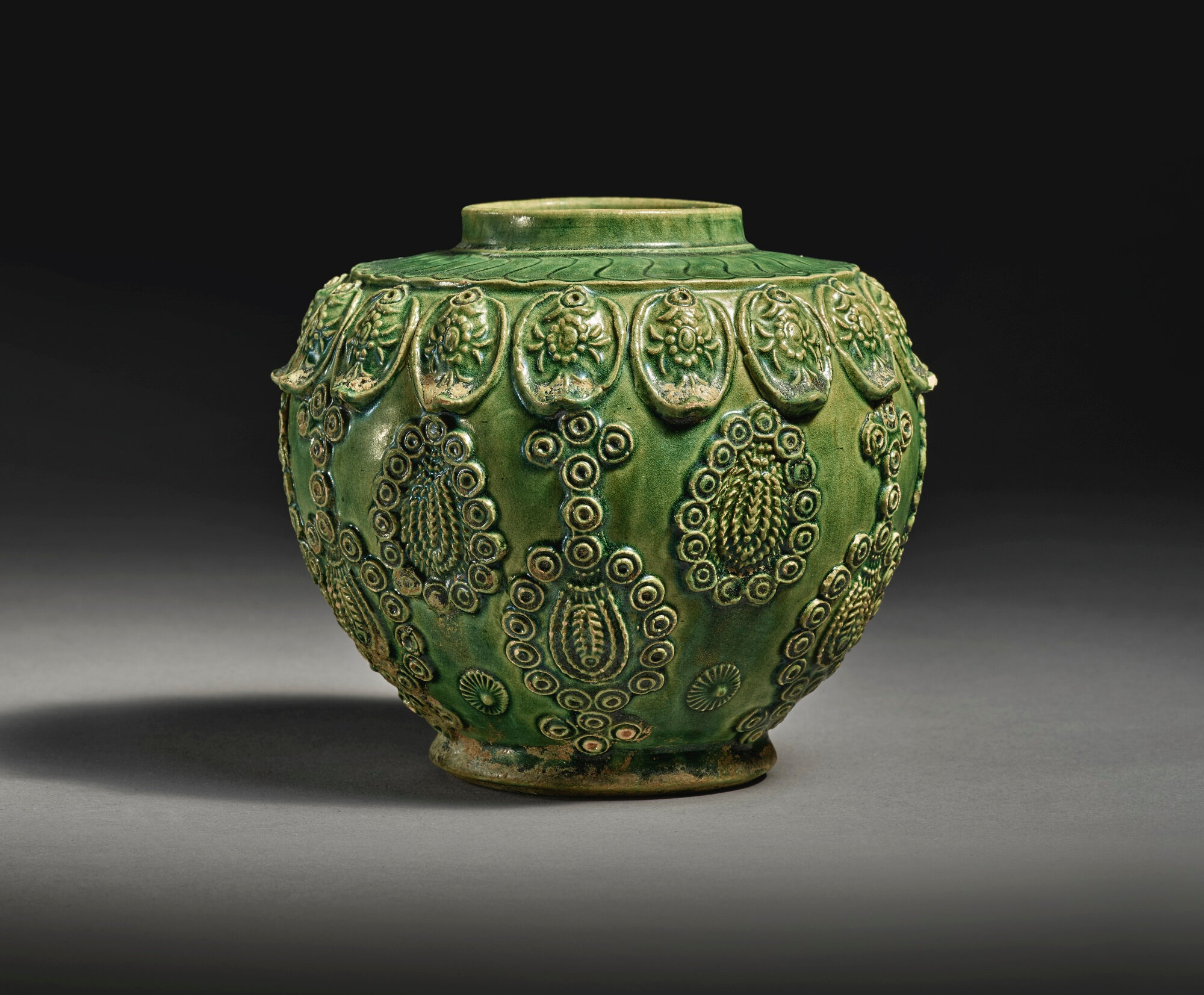A rare molded green-glazed pottery jar, late Tang-Liao dynasty
